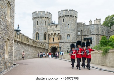 Berkshire, England - 21 July 2016 : Windsor guard in red uniform walking around Windsor castle, Berkshire, United Kingdom on 21 July 2016