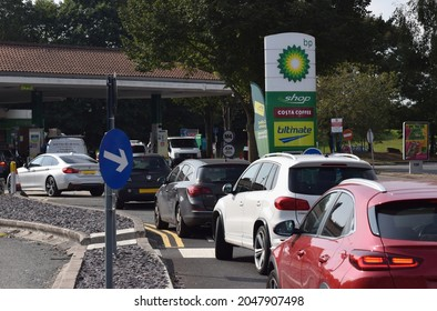 Berkshire UK. Sept 26 2021. Queuing cars waiting to buy fuel at a BP petrol filling station as British drivers panic buy fuel. Vehicle registration numbers have been redacted in this photo.