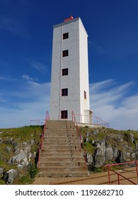 BERLEVAAG, NORWAY JULY 27 2018: Berlevaag lighthouse and watchmen buildings in summer