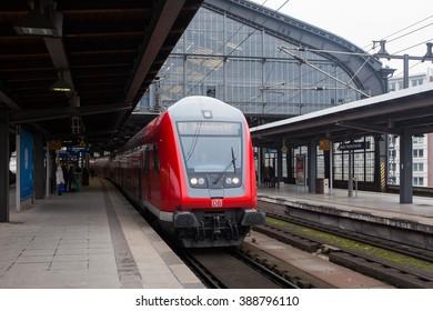 """BERLIN, 10 MARCH: A regional train arrives to the train station """"Bahnhof Friedrichstrasse"""" in Berlin on 10 March 2016."""