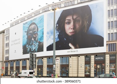 BERLIN, 11 MARCH: Huge bill board advertising panel for iPhone 6S covering a building under construction in Potsdamer Platz in Berlin on 05 March 2016.