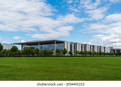 """Berlin 2021: Paul-Löbe-Haus, a functional building of the German Bundestag in Berlin's government district, with the famous """"Charité"""" hospital in the background."""