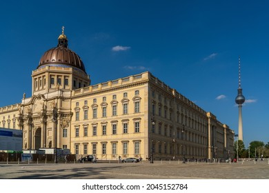 Berlin 2021: Berlin Palace (Berliner Schloss), formally the Royal Palace (Königliches Schloss). View from the side on the facade and the dome. The Berlin TV tower in the background on the right.