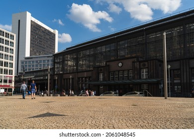 Berlin 2021: View across the forecourt of famous Friedrichstraße station to the entrance and front facade. In the background is the International Trade Center, a high-rise building from GDR times.