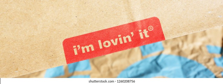 Berlin - 3 September 2018.: Detail of paper bag Mc Donalds with slogan I'm lovin' it. - Image