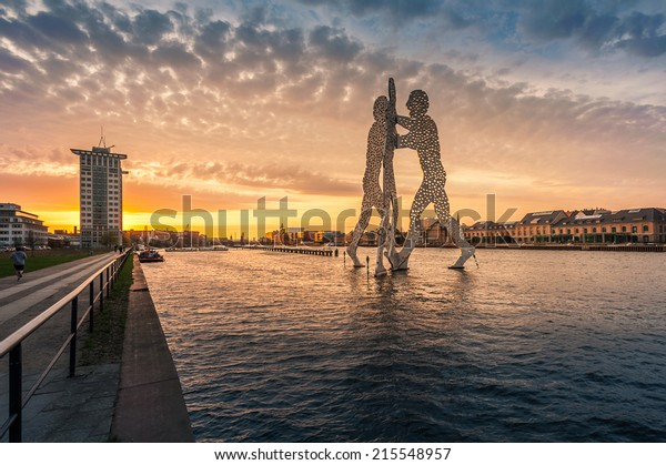 BERLIN - APR 18, 2013: Molecule Man designed by Jonathan Borofsky, on April 18, 2013 in Berlin, Germany. Symbol of the unity of the three restructured in the 2001 district Treptow and Friedrichshain
