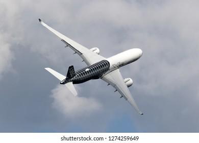 BERLIN - APR 27, 2018: New Airbus A350 XWB passenger jet plane in flight at the Berlin ILA Air Show.