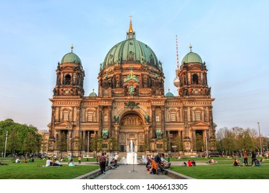 BERLIN - April 19, 2018: Berlin Cathedral (or Berliner Dom, or Evangelical Supreme Parish and Collegiate Church) in Berlin, Germany and people enjoying the good weather.