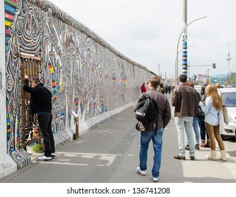BERLIN, APRIL 24: Graffiti at the East Side Gallery on April 24, 2013 in Berlin, Germany. The East Side Gallery is the longest preserved stretch of the Berlin wall. Some parts are being removed now.