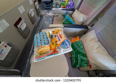 BERLIN - APRIL 26, 2018: Children's menu in the economy class of the world's largest aircraft Airbus A380. Emirates Airline. Exhibition ILA Berlin Air Show 2018