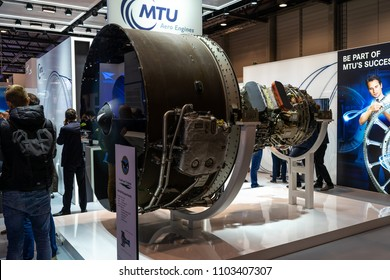 BERLIN - APRIL 26, 2018: The stand of MTU Aero Engines and high-bypass geared turbofan engine family Pratt & Whitney PW1000G. Exhibition ILA Berlin Air Show 2018.