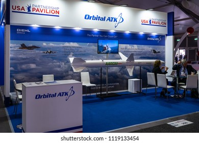 "BERLIN - APRIL 27, 2018: Pavilion ""Defense and Security"", stand of Orbital ATK Inc. American aerospace manufacturer and defense industry company. Exhibition ILA Berlin Air Show 2018."