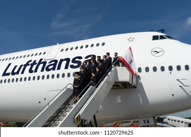 BERLIN - APRIL 28, 2018: The crew of widebody jet airliner Boeing 747-8. Lufthansa. Exhibition ILA Berlin Air Show 2018.