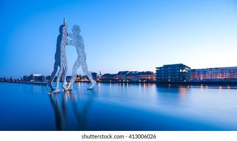 BERLIN - APRIL 29, 2016: The famous Molecule Men and River Spree in Berlin on April 24, 2016.