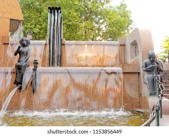 BERLIN, AUGUST 09: World Ball Fountain Water Loops, GERMANY 2017. Statue of coachman in goggles.