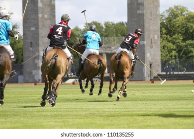 "BERLIN- AUGUST 12- Unidentified Polo players in fast action at ""Berlin Polo Cup"" competition  August 12, 2012 in Berlin, Germany."