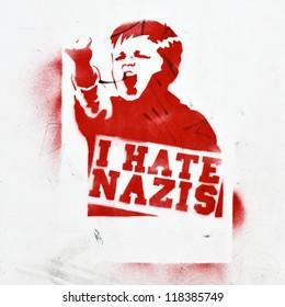 BERLIN - AUGUST 16: Anti-fascist graffiti on a  building wall (I hate nazis) August 16, 2012 in Berlin