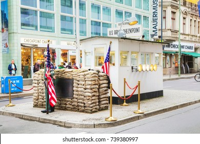 BERLIN - AUGUST 21, 2017: Checkpoint Charlie on August 21, 2017 in Berlin, Germany. The name was given by the Western Allies to the best-known Berlin Wall crossing point between East and West Berlin.