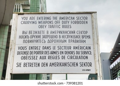BERLIN - AUGUST 21, 2017: Historical sign at Checkpoint Charlie on August 21, 2017 in Berlin, Germany. The name was given by the Western Allies to the best-known Berlin Wall crossing point.