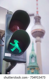 BERLIN - AUGUST 21: Green walking man (Ampelmann) on the traffic light on August 21, 2017 in Berlin, Germany