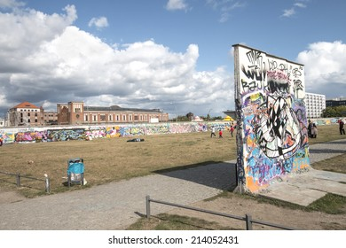 BERLIN - AUGUST 24, 2014 : The East Side Gallery is the largest outdoor art gallery in the world. This photo shows the former death strip with wall segments