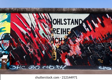 BERLIN - AUGUST 8: East Side Gallery Berlin famous graffiti on August 8, 2014 in Berlin. It is an 1,3 km long part of original Berlin wall with paintings by artists from all over the world.
