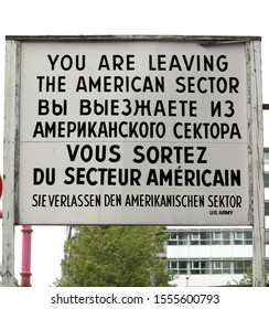 Berlin, B, Germany - August 20, 17: sign at the border point between East Berlin and West Berlin called Check Point Charlie with the inscriptions in American, Russian, French and German