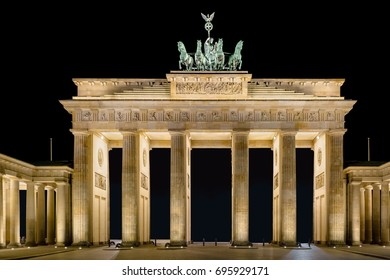 The Berlin Brandenburg Gate at night The view falls from the east side to the gate. The figures of the Quadriga look east.