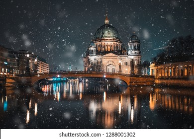 Berlin Cathedral (Berliner Dom) on Spree river snowing in winter time