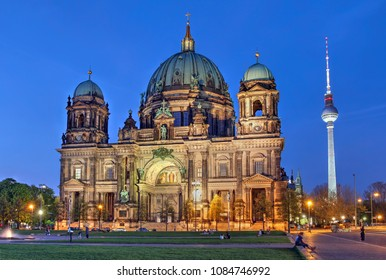 Berlin Cathedral (or Berliner Dom, or Evangelical Supreme Parish and Collegiate Church) at twilight with the TV tower (Fernsehturm) in the background, Berlin, Germany.