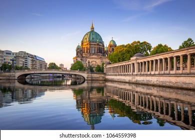Berlin Cathedral reflected in Spree River at dawn, Germany