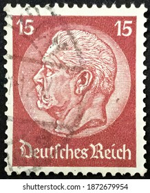 Berlin, circa 1934: Used Deutsches Reich postage stamp depicting Paul von Hindenburg (1847-1934), 2nd President in a medallion.