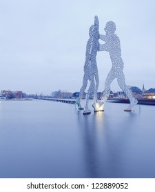 BERLIN - CIRCA 2011: Molecule Man designed by Jonathan Borofsky, on CIRCA 2011 in Berlin, Germany. Symbol of the unity of the three restructured in the 2001 district Treptow and Friedrichshain