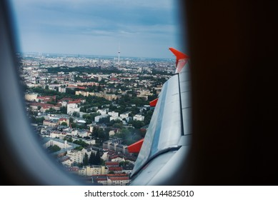 Berlin city view from the aircraft window, airplane landing in Germany