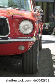 BERLIN CLASSIC CAR SHOW – JUNE 18, 2017: Headlights of a classic red Ford Mustang car