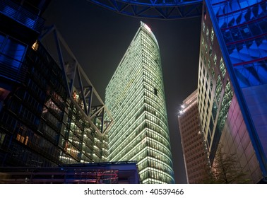 Berlin commercial center with modern office building in the night, Germany