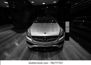 BERLIN - DECEMBER 21, 2017: Showroom. Subcompact executive car Mercedes-Benz CLA-Class CLA 220d Peak Edition. Black and white. Since 2014.