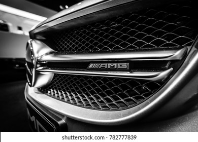 BERLIN - DECEMBER 21, 2017: Showroom. Detail of the mid-size car Mercedes-Benz C-Class AMG C63 (W205). Black and white. Since 2015.
