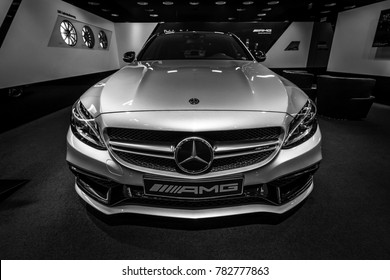 BERLIN - DECEMBER 21, 2017: Showroom. Mid-size car Mercedes-Benz C-Class AMG C63 (W205). Black and white. Since 2015.
