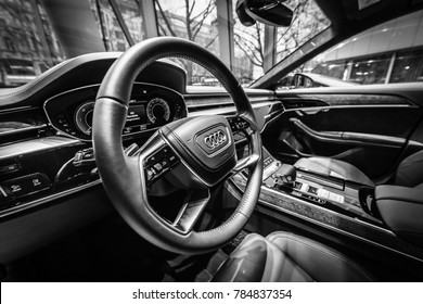 BERLIN - DECEMBER 21, 2017: Showroom. Interior of the full-size luxury car Audi A8 3.0 TDI quattro (286PS). Since 2018. Black and white.