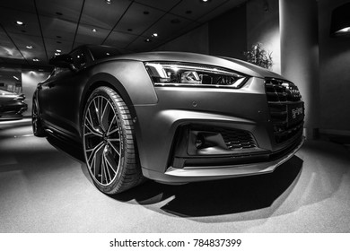 BERLIN - DECEMBER 21, 2017: Showroom. Compact executive car Audi A5 Sportback g-tron. Since 2017. Black and white.