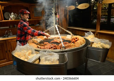 BERLIN - DECEMBER 26: Unidentified people trades food in annual traditional Christmas fair in Alexanderplatz on 26 December 2014 in Berlin, Germany.