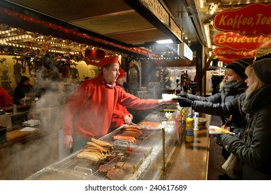 BERLIN - DECEMBER 26: Unidentified people trade food in annual traditional Christmas fair in Charlottenburg (Quarter of Berlin) on 26 December 2014 in Berlin, Germany.