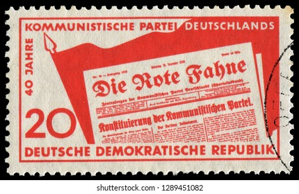 """Berlin, East Germany - Dec. 30, 1958: Forty years of Communist Newspaper """"The Red Flag""""and German Communist Party. Stamp issued by East Germany in 1958."""