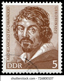 Berlin, East Germany - Sept. 1973: Michelangelo da Caravaggio (1571-1610), famous Italian painter who had a deep influence on Baroque painting. Stamp issued by East German Post in 1973.