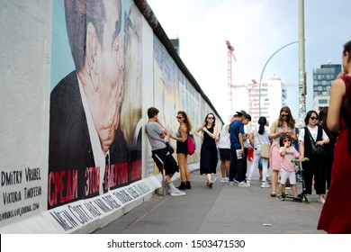 Berlin, east side gallery / Germany - September 2019: Famous art on Berlin wall remains - fraternal kiss between Erich Honecker and Leonid Brexhnev