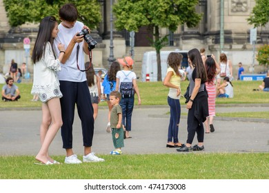Berlin, EU/Germany - July 21-07-2016 - Asian photograper is making pictures with his DSLR camera from a woman model. The pictures are made in front of the church Berliner Dom.