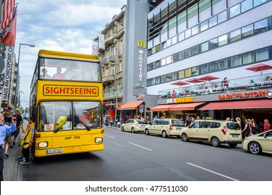Berlin, EU/Germany - July 21-07-2016 - City Tour bus is parked near by the touristic place Checkpoint Charlie.