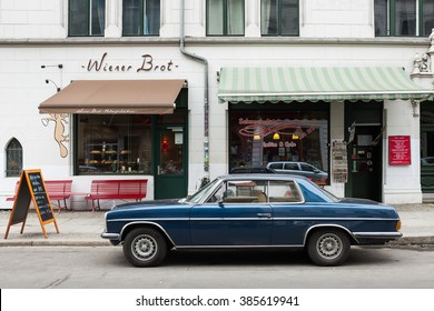 BERLIN - FEBRUARY 29:  Vintage 1970s Mercedes Benz 280 C and food stores in Tucholskystrasse in Berlin on 29 February 2016.