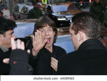 BERLIN - FEBRUARY 7: Mick Jagger leaves the press conference 'Shine A Light' at the Grand Hyatt Hotel of the 58th Berlinale Film Festival on February 7, 2008 in Berlin, Germany